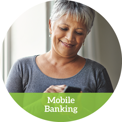middle-aged woman happily using her smartphone (mobile banking button)