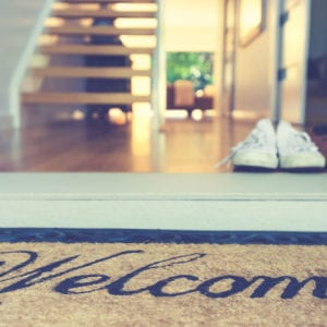 a welcome mat leading into a beautiful home
