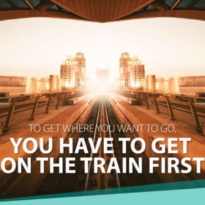 "ad image of train tracks with vanishing point with tagline ""to get where you want to go, you have to get on the train first."""