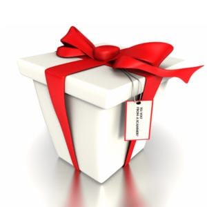 "A white gift box with a red bow on it with a tag that reads ""to: you, from: a scammer?"""