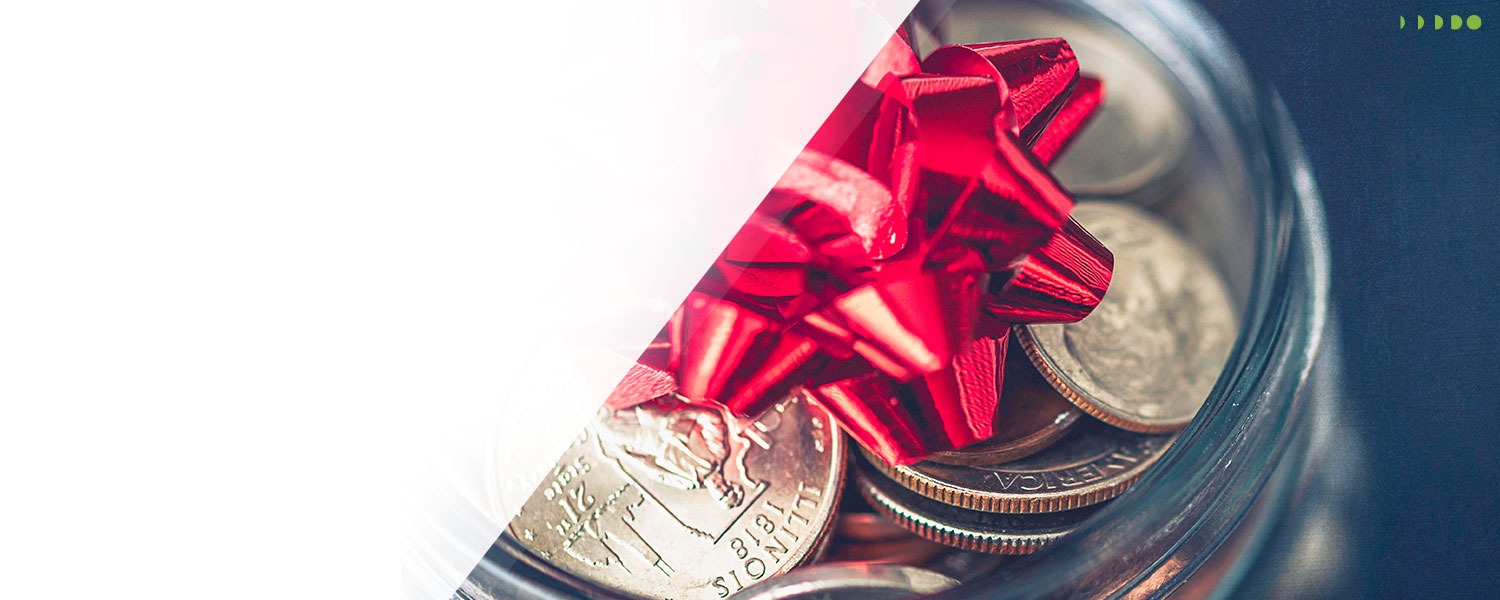 Slider image for January's Holiday Loan showing a jar filled with coins with a red bow on it