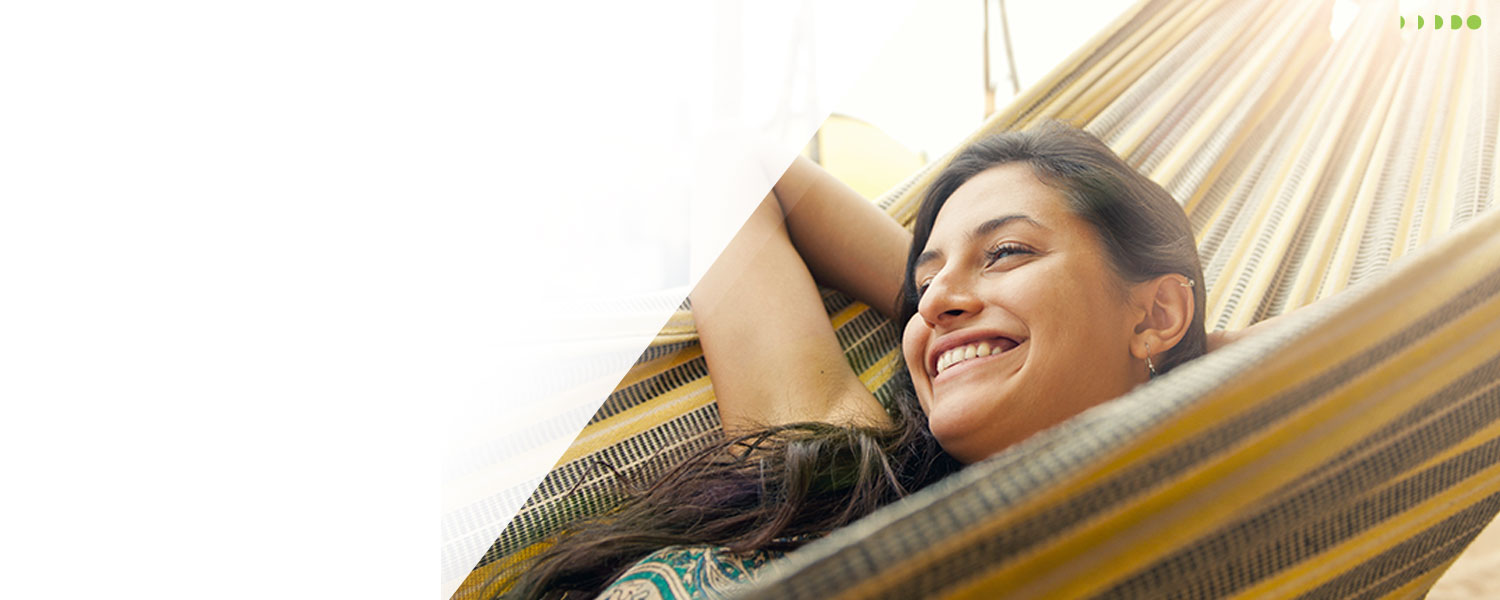 Slider image of young woman relaxing in a hammock